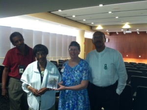 Friends volunteer and board member Timothy Jones, left, Home resident Jeanne Beasley, Home Librarian Christine Baldwin and noted historian and author, C. R. Gibbs, pose with the documentary film Friends donated to the Home after a viewing Wednesday night.