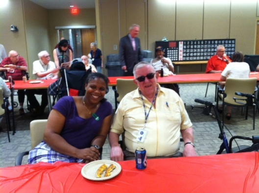Friends volunteer Lori Lincoln is happy to visit with Mr. Brotski during the monthly Happy Hour on July 30.