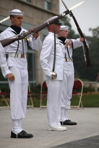 A U.S. Navy drill team stunned the audience and received several rounds of applause for precision maneuvers during the Scott Building grand opening.