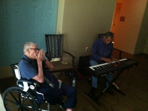 Soldiers Home resident Patrick ``Goldy'' Goldsworthy jams on harmonica with volunteer keyboardist Michael Price at the monthly Saloon Night. Photo by Zach Hartman.