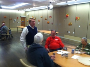 Friends volunteer Eric Hagerson shares some insights with a table of residents at the monthly Happy Hour on Tuesday, Nov. 26.