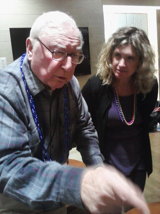 Photo: Friends volunteer Kerry Hamblin pays close attention as veteran Charles Setzer performs a card trick during Saloon Night With Friends on March 4. Unfortunately for Kerry and others, Mr. Setzer wouldn't reveal how he did it. Photo credit: Lori Lincoln.