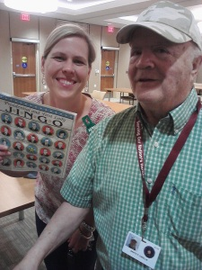Friends volunteer Terra Zvara is happy to greet a new resident of the Armed Forces Retirement Home, Mr. Dibella, at Jingo Night on May 8. (Photo by Lori Lincoln)